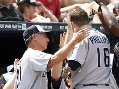 Kyle Phillips celebrates with Padres manager Bud Black after his first major league home run produced the go-ahead run in San Diego's win at Atlanta.