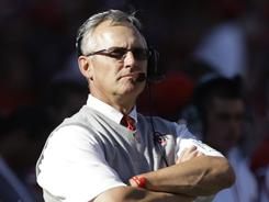 Football coach Jim Tressel resigns amid an investigation into his program, Ohio State says.