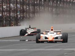 Dan Wheldon takes the checkered flag at Indaianapolis Motor Speedway.
