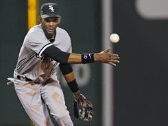 Alexei Ramirez turns a double play in Chicago's 10-7 win in Boston, where Ramirez went 4-for-5 Tuesday.
