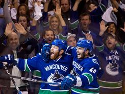 Raffi Torres, left, and Maxim Lapierre helped the Canucks earn the NHL's top record this season before their playoff march.