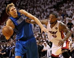 Miami Heat forward Udonis Haslem defends against Dirk Nowitzki during the Heat's NBA Finals Game 1 victory in Miami.