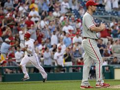Cliff Lee, right, reacts after giving up a three-run homer to Danny Espinosa. The second baseman now leads all rookies in home runs.