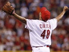 Reds closer Francisco Cordero celebrates after recording his 300th career save Wednesday against the Brewers.