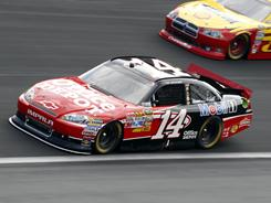 Tony Stewart (14) will drive a Chevrolet promoting the second-season premiere of The Glades on Sunday night on A&amp;E.