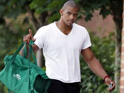 Ohio State quarterback Terrelle Pryor walks to a players-only meeting on Monday.