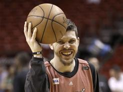 Miami Heat's Mike Miller laughs during practice, on Wednesday. He has been balancing responsibilites to the team and his ill newborn daughter.