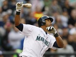 Mariners rookie Carlos Peguero hits two of Seattle's four home runs, a season high, in an 8-2 win over the Tampa Bay Rays.