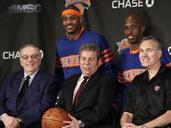 New York Knicks president Donnie Walsh, far left, announced Friday he's leaving after discussions with Madison Square Garden chairman James Dolan, center. Walsh pulled off the February trade that brought Carmelo Anthony and Chauncey Billups, standing, to the Knicks and coach Mike D'Antoni, right.