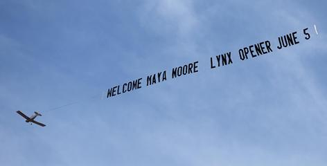 An airplane flies over Minneapolis to welcome new addition Maya Moore, the No. 1 overall pick in the 2011 draft, and promote the Lynx home opener.