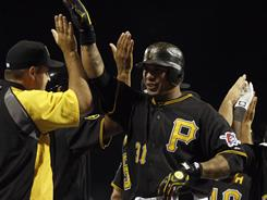 Jose Tabata (31) celebrates his game-winning single after the Pirates defeated the Phillies 2-1 in 12 innings on Friday. It was Tabata's only hit of the game in five at bats.