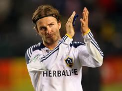 David Beckham of the Los Angeles Galaxy applauds to the fans after an MLS match against D.C. United at The Home Depot Center in Carson, Calif. The teams played to a 0-0 draw.