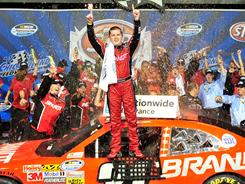 Justin Allgaier celebrates his second career Nationwide Series victory.