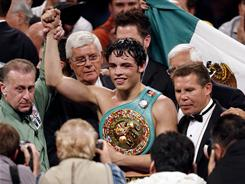Julio Cesar Chavez Jr. celebrates his new WBC middleweight title after defeating Sebastian Zbik by majority decision.