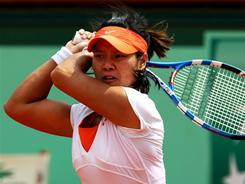 Li Na of China rifles a backhand on her way to a 6-4, 7-6 (7-0) victory against 2010 champion Francesca Schiavone of Italy in the final of the French Open on Saturday in Paris. Li becomes the first Chinese player to win a Grand Slam singles title.