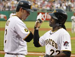 Andrew McCutchen, right, had three hits and a pair of RBI and Brandon Wood, left, homered as the Pirates won their fourth in five games.