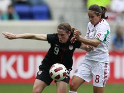 Midfielder Heather O'Reilly, left, and Mexico midfielder Lupita Worbis compete for the ball during the first half of a women's  international friendly soccer game June 5 in Harrison, N.J. It was Team USA's last friendly game in the U.S. before they head to Germany for the Women's World Cup which begins June 26.
