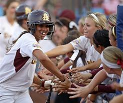 Arizona State's Alix Johnson, left, celebrates with teammates after scoring against Florida during the Women's College World Series finals in Oklahoma City on June 6.