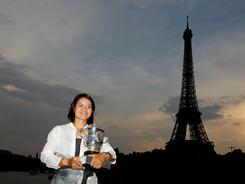 Li Na poses for photos with her French Open trophy on Sunday in Paris.