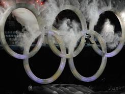 A snowboarder leaps through the Olympic rings at the opening ceremonies of the 2010 Winter Games in Vancouver. NBC paid $820 million for the television broadcast rights to those Games.