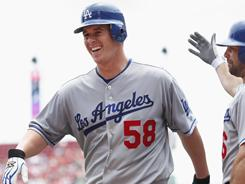 Chad Billingsley smiles after rounding the bases following his home run in Sunday's win.