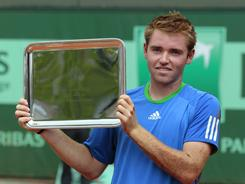 Bjorn Fratangelo of the U.S. shows off his trophy defeating Dominic Thiem of Austria 3-6, 6-3, 8-6 to win the boys juniors title at the French Open on Sunday in Paris.