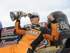 Spencer Massey celebrates his win in the Top Fuel division at the 42nd Annual NHRA SuperNationals in Englishtown, NJ.