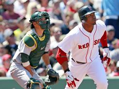 Carl Crawford, right, hit his first home run of the season at Fenway Park on Sunday against the A's. Crawford now has five home runs and 29 RBI in 2011.