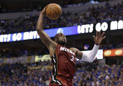 Miami Heat guard Dwyane Wade dunks during the first half of Game 3 of the NBA Finals against the Mavericks in Dallas.