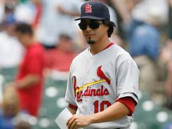 Kyle Lohse, dressed as Cardinals manager Tony La Russa, walks off the field after exchanging lineup cards before a game against the Chicago Cubs at Wrigley Field. Lohse is among the players who bring levity to a team that has seen more than its share of injuries.