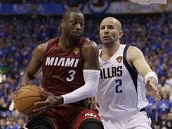The Heat's Dwyane Wade, left, driving against the Mavericks' Jason Kidd, is averaging 29 points a game and shooting 56.7% from the field in the Finals.