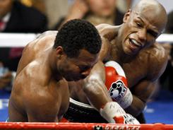 Floyd Mayweather Jr.,connects on a right hand against Shane Mosley, during his last fight on May 1, 2010, in Las Vegas. Mayweather won by unanimous decision.