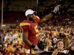 USC's Reggie Bush, seen here celebrating after a December 2005 win over UCLA, had his feats wiped off the NCAA books.
