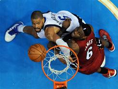The Heat's LeBron James (6) and the Mavericks' Tyson Chandler go after a rebound during the second half of Game 4 Dallas won 86-83 to tie the series at 2-2.