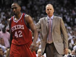 Head coach Doug Collins, right, and power forward Elton Brand led the 76ers to a 41-41 record. Philadelphia lost to the Miami Heat in the first round of the playoffs.