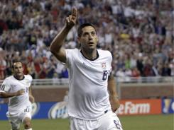 Clint Dempsey (8) celebrates his 62nd-minute goal that helped the USA open Gold Cup play with a shutout of Canada.