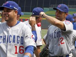 Chicago Cubs' Carlos Pena, right, and Aramis Ramirez (16) are congratulated.