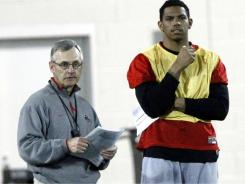 Former Ohio State coach Jim Tressel, left, and former quarterback Terrelle Pryor watch spring practice earlier this year before they departed the team.