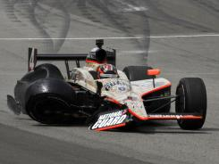 J.R. Hildebrand slides across the track after crashing before the Indy 500 finish line.