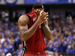 Heat forward LeBron James took one fourth-quarter shot in Tuesday's loss to the Mavericks.