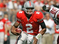 In this 2008 file photo, Ohio State quarterback Terrelle Pryor runs against the Troy defense in Columbus, Oh. The Saskatchewan Roughriders have acquired the negotiating rights to Pryor and have spoken to him about bringing him to the Canadian Football League.