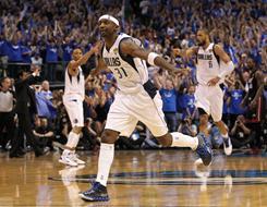 The Dallas Mavericks' Jason Terry celebrates his three-pointer late in a Game 5 victory over the Miami Heat in Dallas.