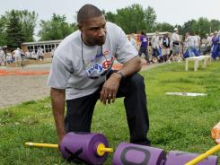 Vikings coach Leslie Frazier helped build a playground in Minnesota last week.