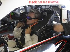 Trevor Bayne checks his seat belt in his garage last Friday during practice for the inaugural STP 300 Nationwide Series race Chicagoland Speedway.