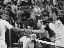 John McEnroe, right, meets Bjorn Borg at the net after winning the U.S. Open in 1981. Their intense but short-lived rivalry is the subject of a documentary that debuts on HBO on Saturday.
