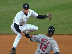 Derek Jeter turns a double play during a 1998 games against the Indians.