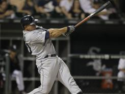 Miguel Olivo had three RBI, including a two-run 10th inning double in the Mariners' 7-4 win over the White Sox on Wednesday night.