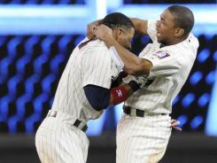 Ben Revere, right, and Alexi Casilla celebrate Casilla's game-winning RBI single in the bottom of the ninth.