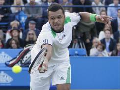 Jo-Wilfred Tsonga plays a return to Rafael Nadal during their match at the Queen's Club in London on Friday. Tsonga dropped the first set before ousting Nadal 6-7 (3-7), 6-4, 6-1.