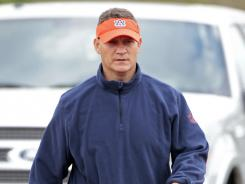 Auburn coach Gene Chizik arrives for the first day of spring football practice in Auburn, Ala., March 23.